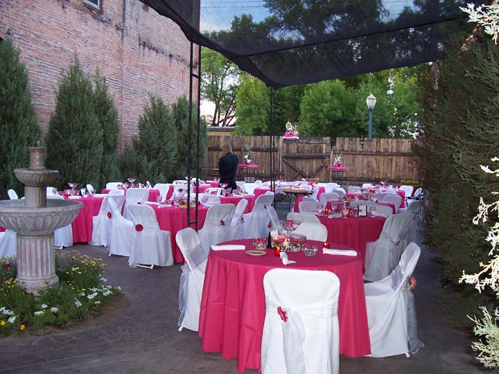 Bistro garden wedding with full chair covers and fuchsia linens