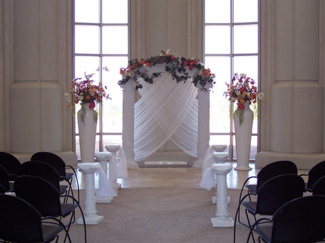 Decorated grecian arch with crossing chiffon creates a beautiful background