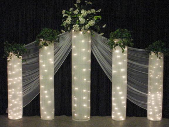 Columns And Greenery Create An Elegant Background For Your Wedding