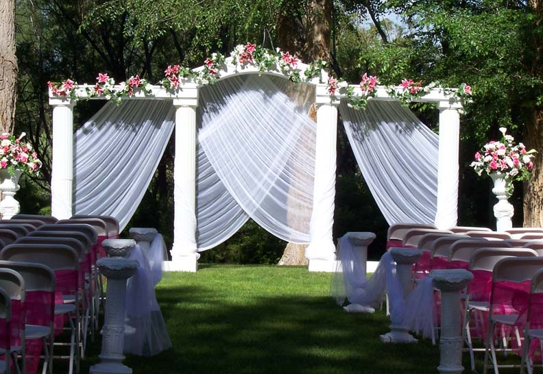 Outdoor Grecian Set with fuchsia florals and Chair Sash 39s on white chairs