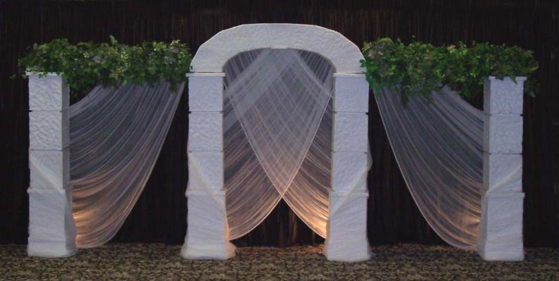 Square Grecian set with arch and crossing chiffon is a beautiful backdrop