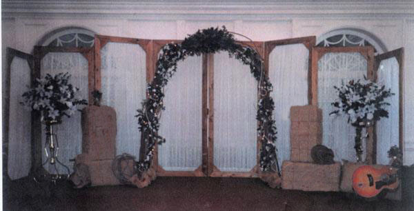 flowers run thru to create a western arch to frame the couple Artifical